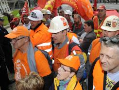ArcelorMittal steel workers demonstrate in front of the company's headquarters May 8, 2012 during a general meeting of shareholders in Luxembourg.