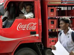 A man walks past a truck that distributes Coca Cola in Mumbai, India, in June 2012.