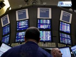 Traders work at the Goldman Sachs post on the floor of the New York Stock Exchange in this March 15, 2012 photo.