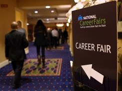 Job seekers arrive at a job fair on July 16, 2012, in San Mateo, Calif.