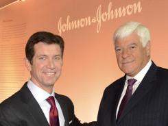 Incoming CEO Alex Gorsky, left, poses with outgoing CEO Bill Weldon April 26, 2012 at the company's headquarters in New Brunswick, N.J.