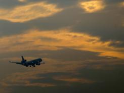 A plane prepares to land at Newark Liberty International Airport on June 20, 2012.
