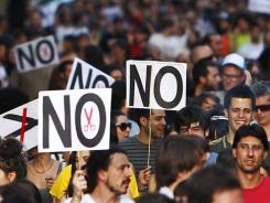 Demonstrators protest against the recent austerity measures announced by the Spanish government in Madrid on Friday July 13, 2012.