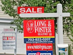 For sale signs sit in front of adjacent homes in this file photo.