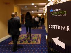 Job seekers arrive at the National Career Fairs' San Francisco South Career Fair on July 16, 2012 in San Mateo, Calif.