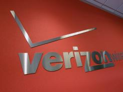 A Verizon sign at a Verizon store in Mountain View, Calif. on Tuesday, June 12.