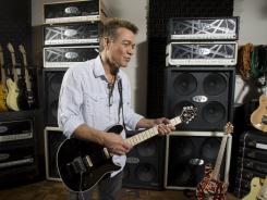 Eddie Van Halen riffs on a Fender guitar called the Wolfgang, after his son. He was photographed in his personal studio in L.A. in 2008.