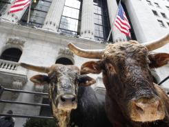 Real bulls appeared in front of the New York Stock Exchange Jan. 5, 2012 to promote the Professional Bull Riders annual event at Madison Square Garden. Bullish investors are almost as rare.