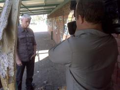 CNN anchor Anderson Cooper, shown on assignment in Israel near the Gaza border in 2009, initially didn't want viewers to see him as more than a reporter but decided this month to say he's always been gay.
