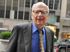 Rupert Murdoch enters the News Corp. building in New York last July.