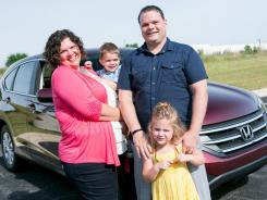 Erin and Nick Ravelingeen, with children Trudy and Mason, helped five auto experts check out six compact SUVs under $25,000.