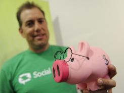 Think pig: Social Money President Scott McCormack promotes social-banking system SmartyPig.