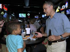 President Barack Obama talks with a youngster during his campaign stop at Ziggy's Pub and Restaurant in Amherst, Ohio, July 5, 2012.