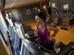 Lauren Walker works out in a Charlotte Ritz Carlton hotel. A survey gave the chain high ratings.