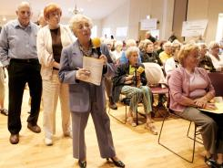 In 2005, senior citizens at the Laguna Woods Village senior community ask questions regarding Medicare Part D, the federal government's national prescription drug insurance program.
