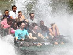 Splashdown: Monsoon Falls riders get soaked at Six Flags Discovery Kingdom in Vallejo, Calif.