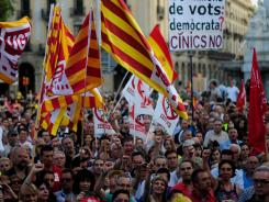Demonstrators protest last week in Barcelona against austerity measures by the Spanish government.