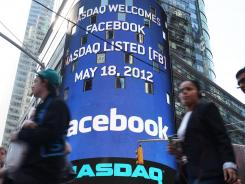 The Nasdaq board in Times Square advertises Facebook's IPO on May 18, 2012 in New York City.