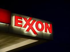 An Exxon sign at a gas station in Manassas, Va.