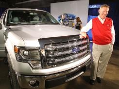 Alan Mulally, president and CEO of Ford Motor Co., stands next to the new 2013 Ford F-150 pickup truck.