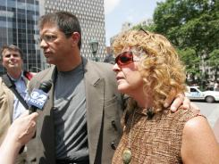Dominic Abrosino, an ex-corrections officer, and his wife Ronnie Sue, victims of Madoff's Ponzi scheme, outside the federal courthouse in New York City June 29, 2009.