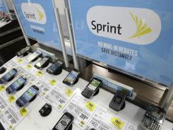 Sprint phones are displayed at a Best Buy in Mountain View, Calif. in this July 17, 2012, photo.