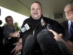 Kim Dotcom, founder of the file-sharing website Megaupload, speaks outside an Auckland, New Zealand, courtroom in February.