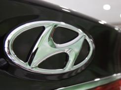Hyundai Motor Co. is recalling some Santa Fe SUVs and Sonata sedans because of problems with their air bags.