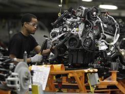 A Chrysler employee works the assembly line at the Jefferson North Assembly plant in Detroit