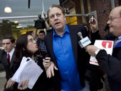 Tough times: Former Boston Red Sox pitcher Curt Schilling, center, departs the Rhode Island Economic Development headquarters in Providence on May 21. His company, 38 Studios, filed for Chapter 7.
