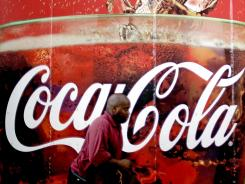 A billboard for Coca Cola outside a convenience store in Atlanta July 16, 2012.
