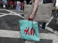 A shopper carries bags on Broadway in Manhattan on July 16, 2012 in New York City.