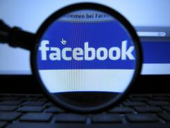The logo of the online network Facebook, recorded in Munich with a magnifying glass of a computer screen of a laptop.