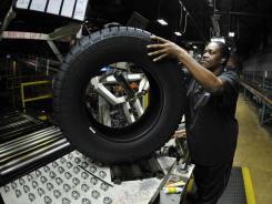 Tire inspector Flora Roundtree checks for defects at a Michelin plant in Greenville, S.C. that produces about 25,000 tires a day.