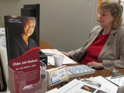 Nancy Seagraves, 61, works at a computer at an AARP office in Columbus, Ohio, through a program that provides financial support and subsidized training for some low-income, older workers while they look for full-time jobs.
