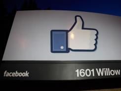 A 'like' sign stands at the entrance of Facebook headquarters in Menlo Park, Calif.
