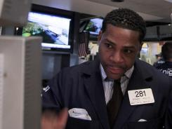 Bernard Wheeler of Knight Capital works on the floor of the New York Stock Exchange June 6, 2012, well before this week's trading problem.