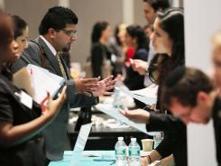 Job seekers attend a career fair sponsored by the jewelry industry July 30, 2012 in New York City. Recruiters from more than 38 companies spoke with potential hires.