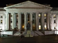 Lights burn at the Treasury Department Aug. 5, 2011 after Standard &amp; Poor's cut the United States' credit rating for the first time in history.