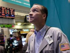 Trader Christopher Crotty works on the floor of the New York Stock Exchange Friday, Aug. 3, 2012.