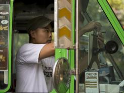 Scanning a card: Andy Nguyen operates a food truck called Lemongrass in the Washington area, with his wife, Uyen. They chose the Square payment system for its size and convenience.