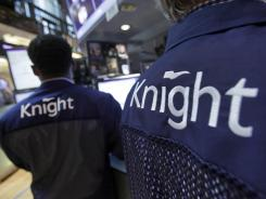 Knight Capital specialists work at their posts on the floor of the New York Stock Exchange Aug. 3, 2012.
