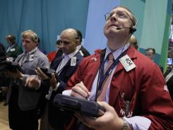 Traders work on the floor of the New York Stock Exchange in this Aug. 3, 2012 file photo.