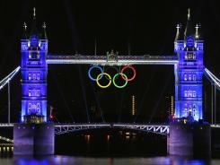 Tower Bridge sports the Olympic rings and is lit up with blue light for the 2012 London Olympic Games opening ceremony.