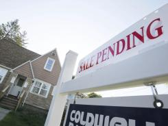 A sign advertises a pending residential real estate sale in Framingham, Mass.