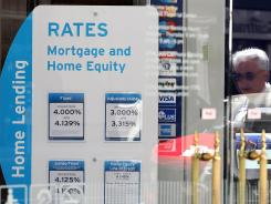 A window displays mortgage rates at a Citibank office in San Francisco, June 7, 2012.