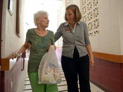 Irene DuRell, 82, in a hallway of Welcome Nursing Home with Jill Herron.