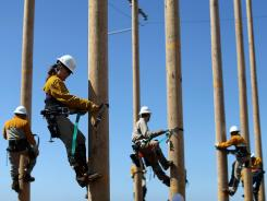 Students in Pacific Gas and Electric's (PG&E) 3-week PowerPathway Pole Climbing Capstone course climb utility poles to prepare to compete for utility industry jobs.