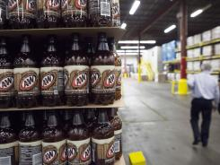 A&W root beer bottles stacked at the Dr Pepper Snapple bottling plant in Houston. Beverage companies are spending to conserve a critical ingredient - water.