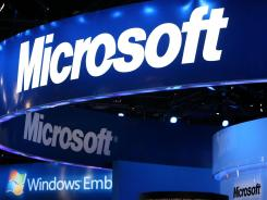 The Microsoft logo is displayed over a booth at the International Consumer Electronics Show.